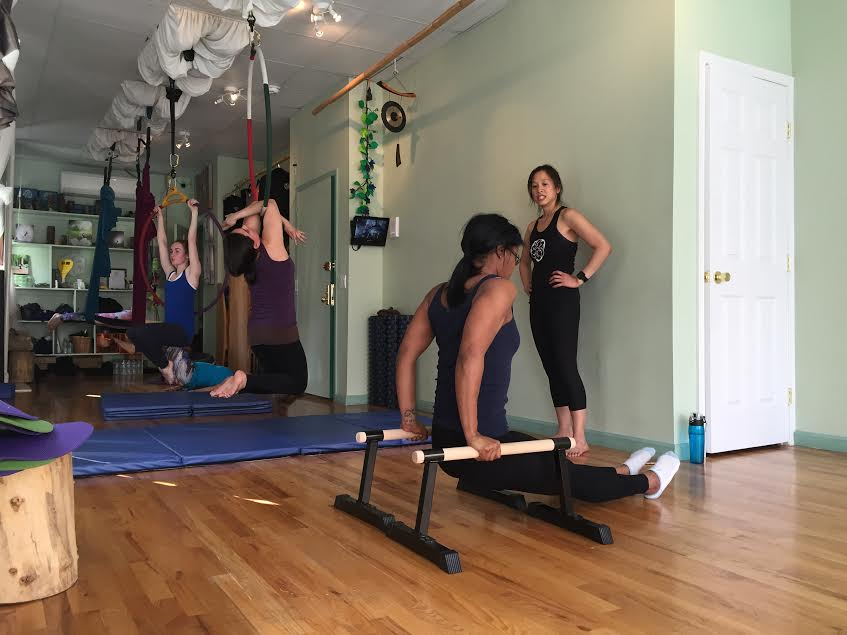 Carolyn Chiu's conditioning class is driven by the basics of gymnastics.