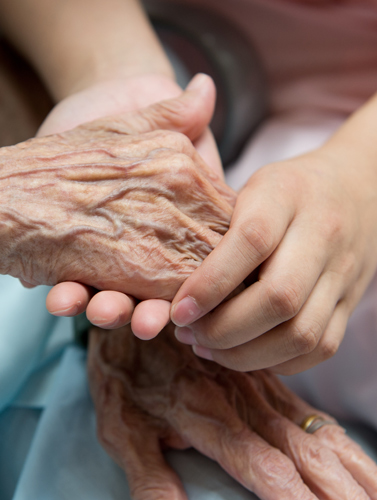 holding aged womans hand