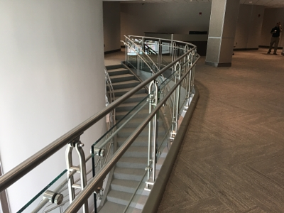 The Railing System Features Glass Brackets Attached To Railing System Using  Continuous Top And Bottom Horizontal Rods.