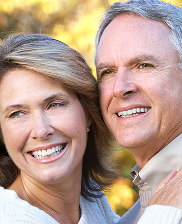 Picture of a senior man and woman smiling