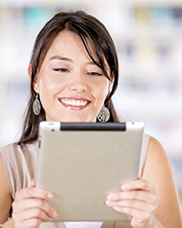 Woman using tablet to verify loal infromation