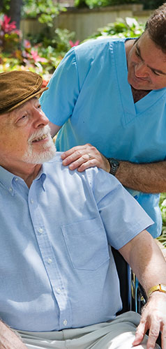 picture of caregiver with senior in garden