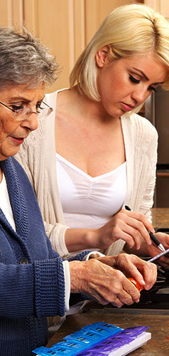 Caregiver reviewing medications with senior