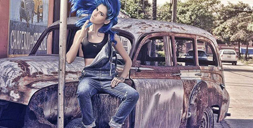 Manic Panic - Girl wearing denim sitting on burnt out car