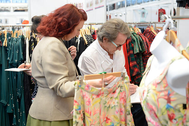 Exhibitors checking order books