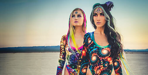 Two models on the beach wearing Multi-coloured Fractal bathing costume