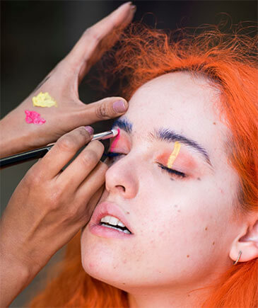 Close-up of make-up being applied to models face