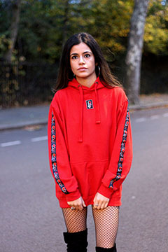 Model wearing 'Evolve' Red Logo Hoodie **Limited Edition** and fish-nets