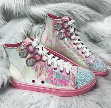 Pink and White boots with glittered toe cap and ankle strap feature
