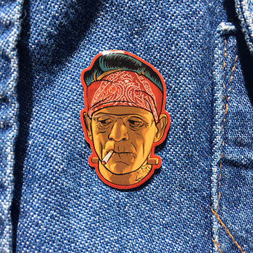 Frankenstein Cholo Lapel Pin on Denim jacket