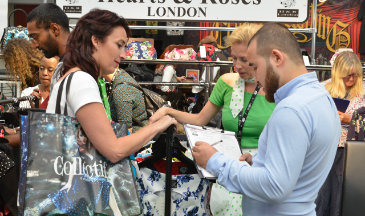 Exhibitor collecting orders from the LondonEdge Trade Show