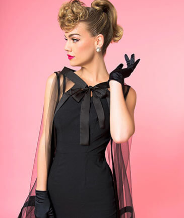 Elegant model wearing Barbie x Unique Vintage Black Magic Sheath Dress & Cape Set