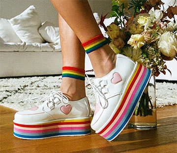 Multicoloured flat platform shoes with heart logo