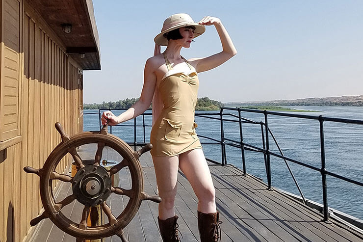 Women on boat looking out to sea, wearing 'Red Dolly' Beige Vintage Explorer swimwear