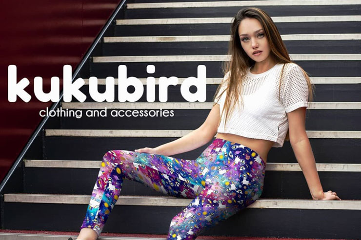 Kukubird Clothing: Model on sitting stairs wearning multi-coloured leggings and white crop top