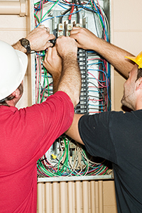 2 Oakwood Electric & Generator Electricians working on an electrical panel