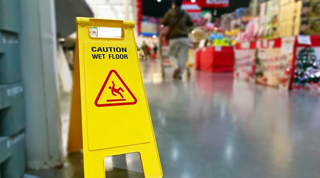 Wet floor cauticon sign inside a grocery store in west palm beach Florida