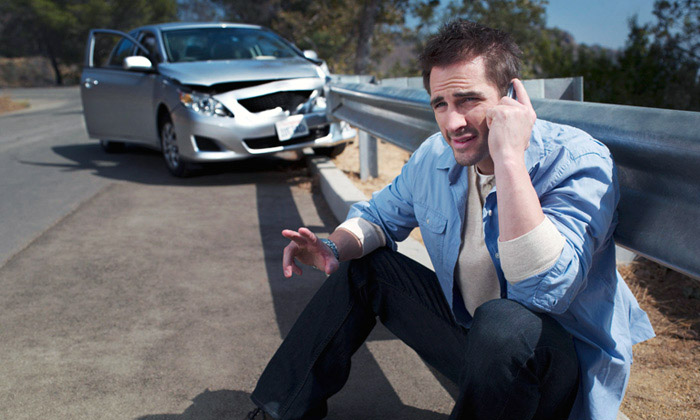 A man on the phone after a car accident