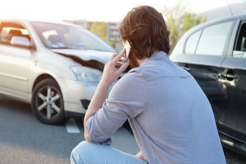 A man calling an injury attorney after an accident