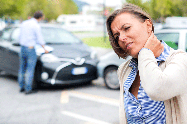 Woman with neck pain after a car accident